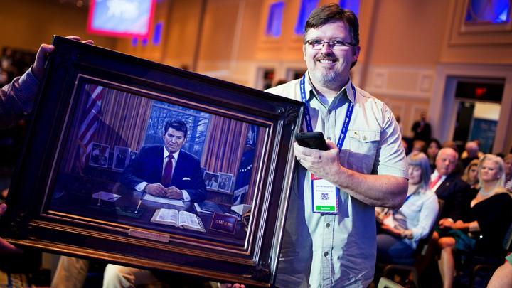 Jon McNaughton shows off a portrait of President Reagan