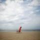 A folding chair on a beach