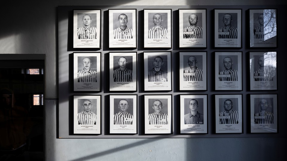 A wall of pictures of former Auschwitz prisoners