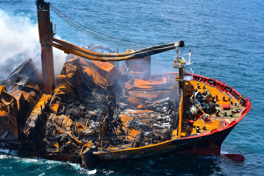 An aerial view of the heavily damaged deck of the burning ship.