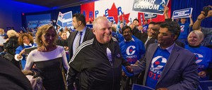 Former Toronto mayor Rob Ford at a political rally with a Canadian flag