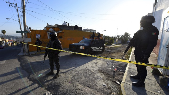 Mexico state police guard the area after a gun battle earlier this year in the the state of Nayarit.