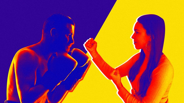 A man and woman face off in boxing stance