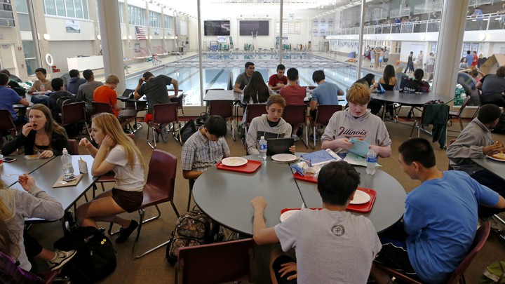 Students eat lunch in a cafeteria
