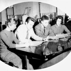 In a picture of Hugh Price from his high school yearbook, he sits with three white students, acting as the vice president for his senior class.