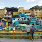 A photo of murals on homes in Medellin, Colombia