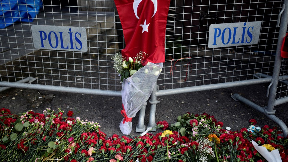 Flowers and a Turkish flag outside the Reina nightclub in Istanbul
