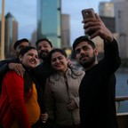 Tourists are pictured taking a selfie.