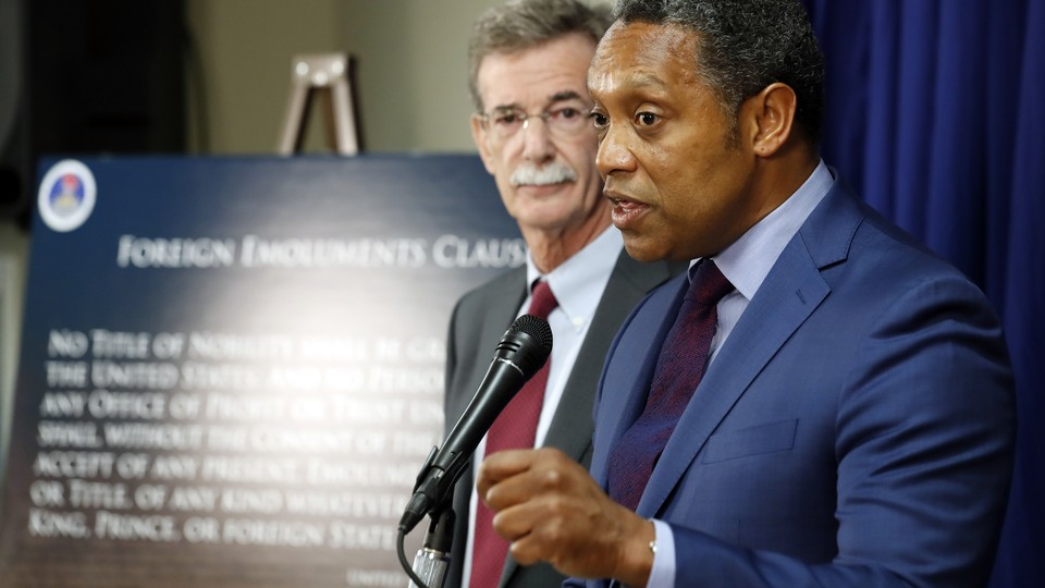 Brian Frosh and Karl Racine, the attorneys general of Maryland and Washington, D.C., announcing their lawsuit against President Donald Trump