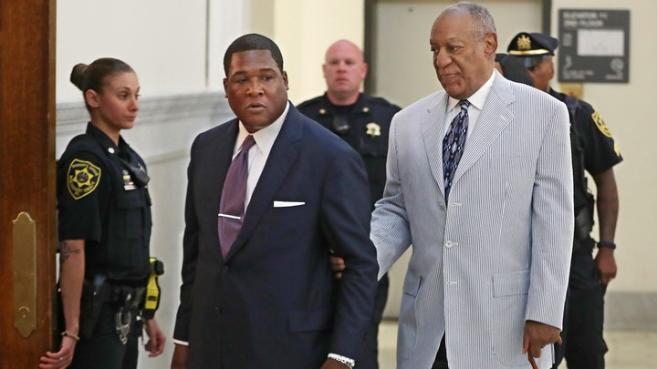 Bill Cosby is led into court