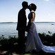 A couple kisses following their wedding ceremony by a lake in Milford, Iowa.