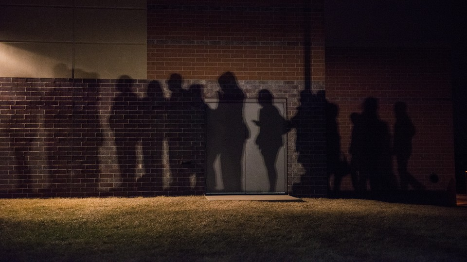 The shadows of voters lined up outside a 2016 caucus location in West Des Moines, Iowa.