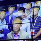 A screen shows the faces of several men as identified by Face++'s facial recognition software.