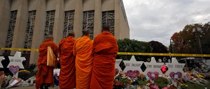 A photo of a group of monks paying their respects at a makeshift memorial outside the Tree of Life synagogue in Pittsburgh.
