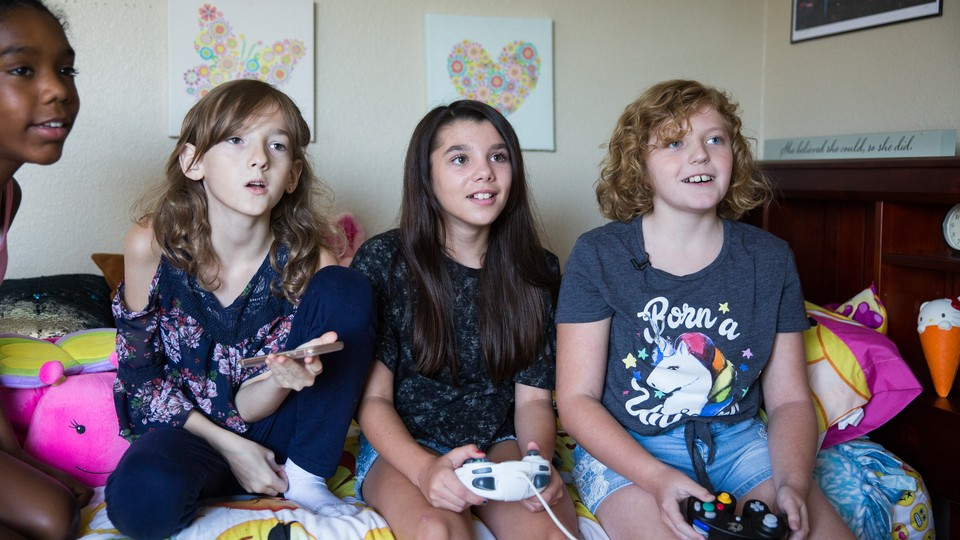 Lily Curran (far right), who is transgender, plays with a group of friends, some of whom are also trans.