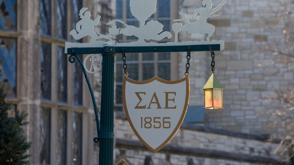 A sign on a lamppost with the initials of Sigma Alpha Epsilon on it