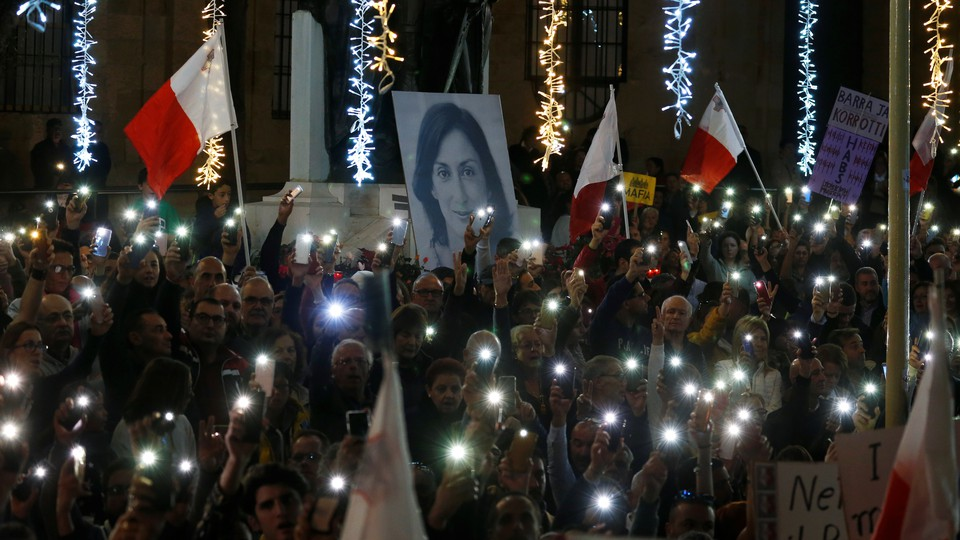 Protesters hold flags of Malta during a demonstration demanding justice over the murder of journalist Daphne Caruana Galizia, outside the Court of Justice, in Valletta Malta.