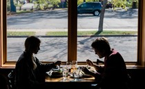 Two people dining indoors at a restaurant