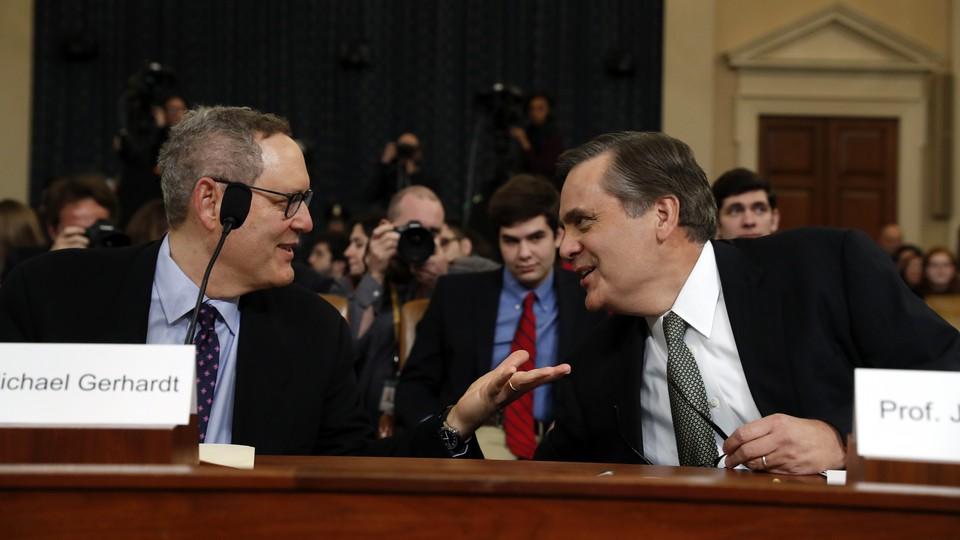The University of North Carolina School of Law professor Michael Gerhardt (left) talks with the George Washington University Law School professor Jonathan Turley.