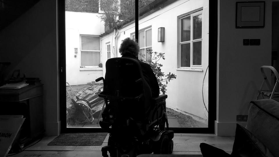 A man sitting by a window.