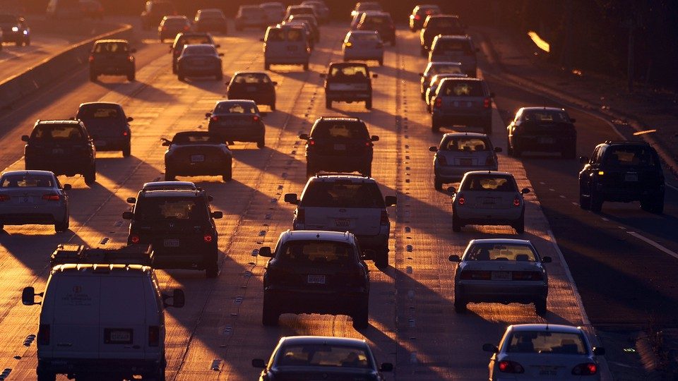 People drive on Highway 134 (Ventura Freeway) at the end of the evening rush hour in Glendale, California.
