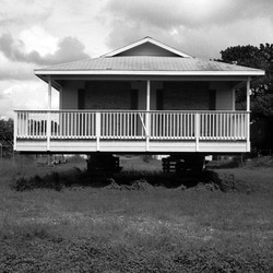 A foreclosed house stands vacant and boarded up in Fort Myers, Florida, in this photo taken during the 2008 recession