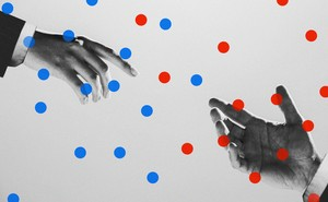 Two hands reaching toward each other, surrounded by blue and red dots