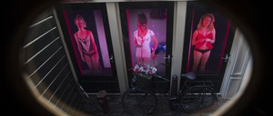 Women pose as sex workers in videos at the Red Light Secrets Museum of Prostitution in Amsterdam's red light district.
