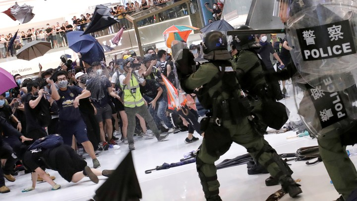 Hong Kong riot police use pepper spray to disperse protesters in a suburban shopping mall.