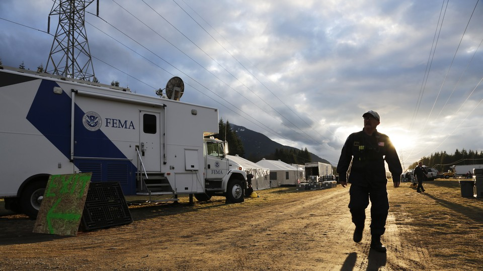 A FEMA worker helping with a mudslide-recovery effort in Darrington, Washington, in March 2014.