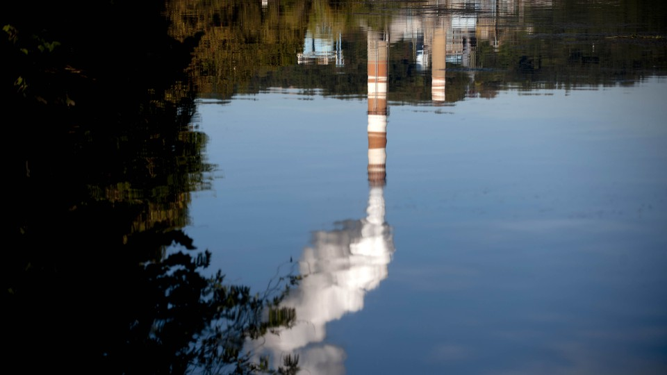 An upside-down reflection of a coal-fired power plant