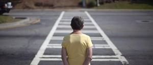 An elderly woman waits to cross an intersection near her Atlanta apartment.