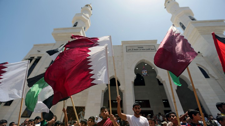 Palestinians take part in a rally in support of Qatar, inside Qatari-funded construction project 'Hamad City', in the southern Gaza Strip onJune 9, 2017.