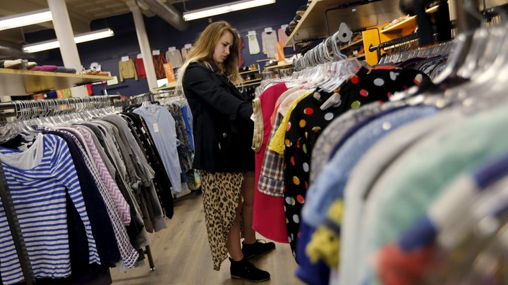 A Millennial shops at a used-clothing store.