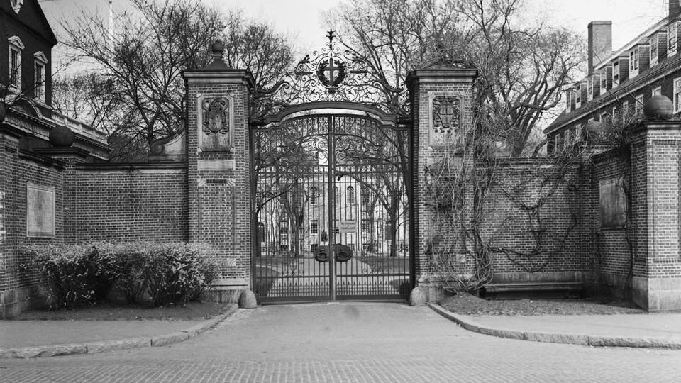 An archival photograph of Harvard University's main gate