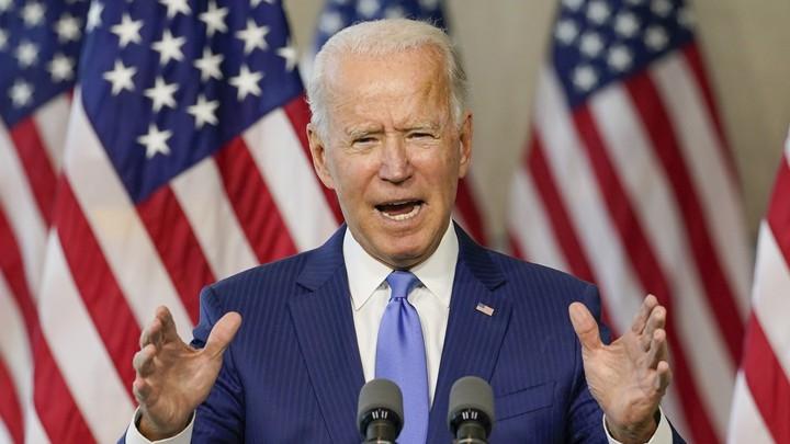 Joe Biden speaking at a microphone