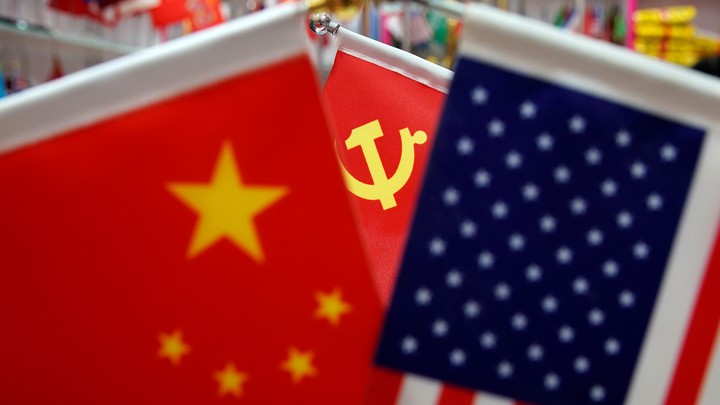 The flags of the U.S., China, and the Chinese Communist Party