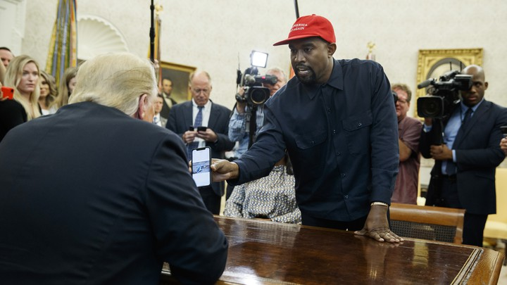 Kanye West shows Donald Trump a photo of a hydrogen plane.