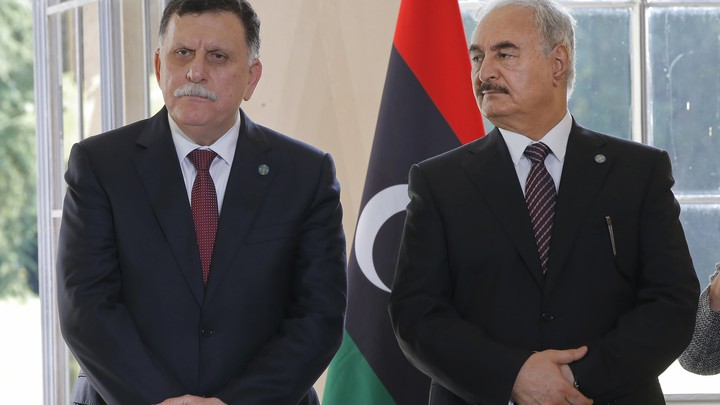 Libyan Prime Minister Fayez al-Sarraj and General Khalifa Haftar declare a ceasefire on July 25, 2017.
