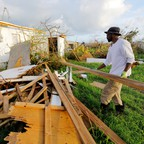 A man clears debris near his home in Frederiksted in St. Croix, U.S. Virgin Islands, hit hard by Hurricane Maria.