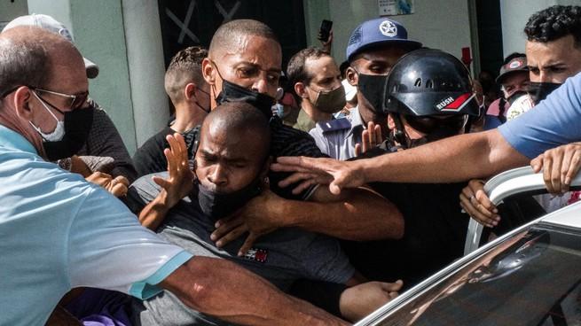 Police detain a protester in Havana.