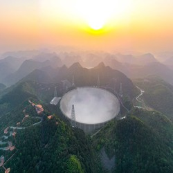 China's FAST telescope sits nestled in a mountainside