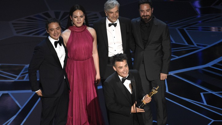 Sebastian Lelio, Juan de Dios Larrain, Daniela Vega, Francisco Reyes, and Pablo Larrain accept the award for Best Foreign Language Film for 'A Fantastic Woman' at the Oscars on Sunday, March 4, 2018, at the Dolby Theatre in Los Angeles