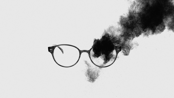 glasses obscured by black fog