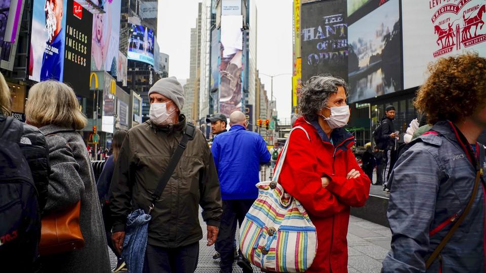 People wearing masks in Times Square