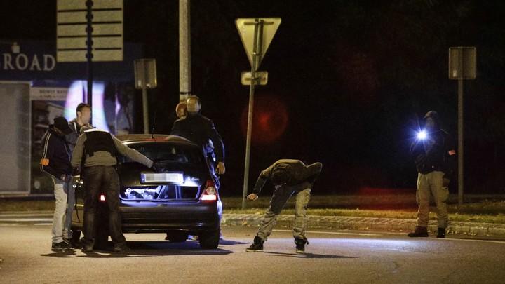 Police inspect a car near a building in Boussy-Saint-Antoine on September 8, 2016.