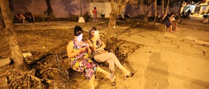 People in Havana gather on benches at night to connect to one of 237 wi-fi hotspots