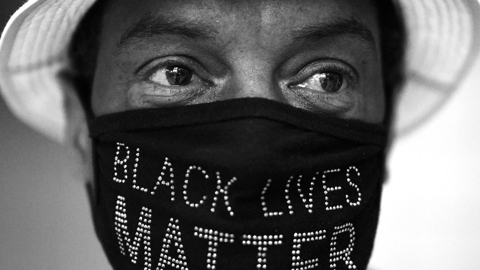 A person wearing a Black Lives Matter face mask.