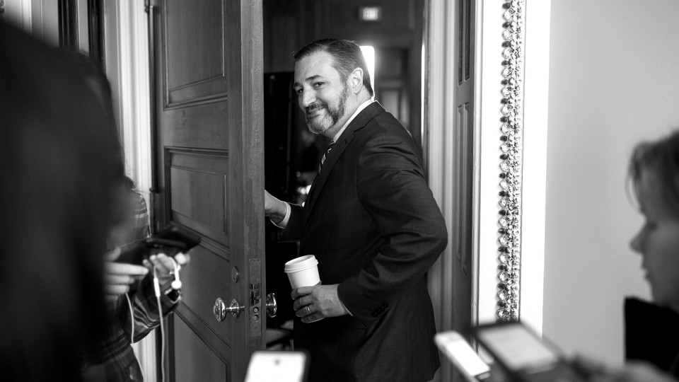 Ted Cruz walking through a door, away from throng of reporters