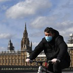 photo: a bicycle rider wearing a mask in London